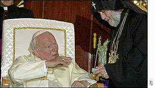 Pope John Paul II receives a gift from Catholicos Karekin II