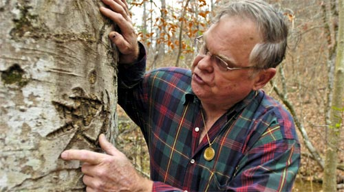CODE: Bob Brewer points out arcane symbols on a tree in western Arkansas that he believes are clues to a treasure stashed away by the Knights of the Golden Circle, a secretive Confederate group.