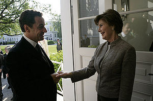 Bro. Nicholas Sarkozy and Sis. Laura Bush Masonic Greeting each other using a secret Freemason handshake 'grip'.
