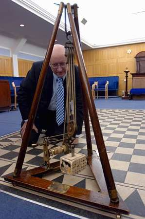 Steve Briggs with ancient stonemasonery equipment kept in the Lodge room at the west corner of the floor