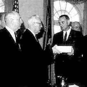 Brother Johnson receiving the Warren Commission Report on the Kennedy Assassination from Brother Warren